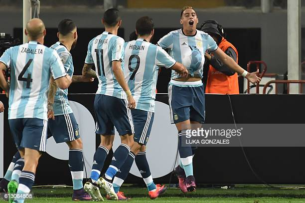 Argentina's Ramiro Funes Mori celebrates with teammates after scoring against Peru during their Russia 2018 World Cup qualifier football match in...