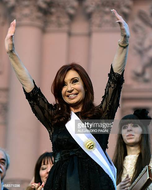 Argentina's reelected President Cristina Fernandez de Kirchner waves during her inauguration ceremony in Mayo square Buenos Aires on December 10 2011...