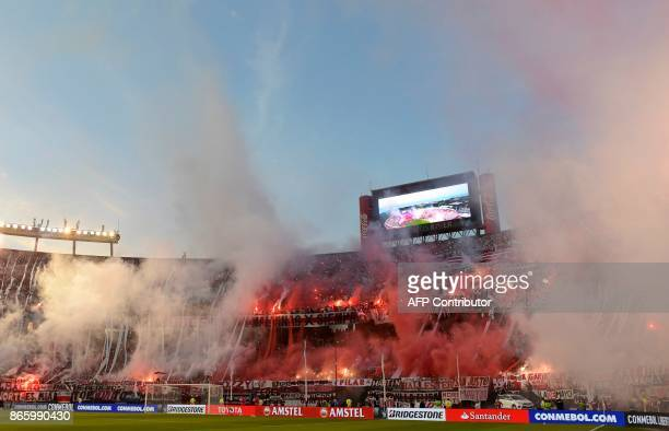 Argentina's River Plate cheer for their team during the 2017 Copa Libertadores semifinal first leg football match against Argentina's Lanus at the...