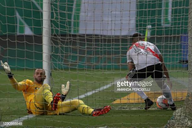 Argentina's River Plate Colombian Rafael Santos Borre gets the ball from the back of the net after scoring past Brazil's Palmeiras goalkeeper...