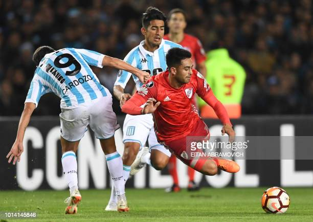 Argentina's River Plate defender Hector Martinez vies for the ball with Argentina's Racing Club midfielder Neri Cardozo during their Copa...