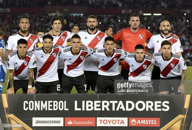 Argentina's River Plate football team pose before the start of the Copa Libertadores 2018 round of sixteen second leg football match against...