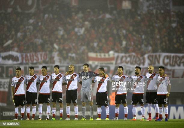 Argentina's River Plate footballers pay homage to Mexican victims of the earthquake before the start of the Copa Libertadores 2017 quarterfinals...