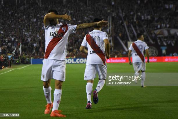 Argentina's River Plate forward Ignacio Scocco celebrates after scoring a penalty against Argentina's Lanus during their Copa Libertadores semifinal...