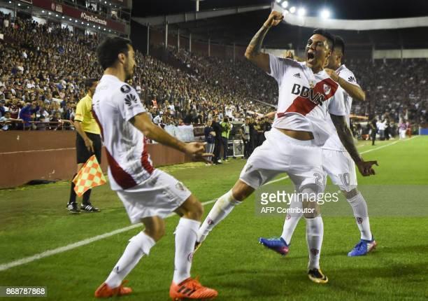 Argentina's River Plate forward Ignacio Scocco celebrates with teammates midfielder Enzo Perez and forward Gonzalo Martinez after scoring a goal...
