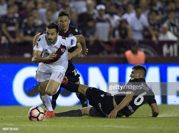 Argentina's River Plate forward Ignacio Scocco drives the ball past Argentina's Lanus defender Diego Braghieri during their Copa Libertadores...