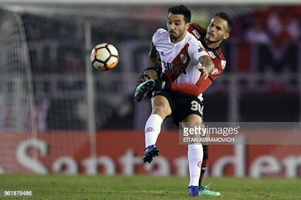Argentina's River Plate forward Ignacio Scocco vies for the ball with Brazil's Flamengo defender Juan during their Copa Libertadores group D football...