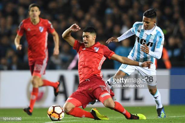 Argentina's River Plate forward Lisandro Lopez vies for the ball with Argentina's Racing Club midfielder Federico Zaracho during their Copa...