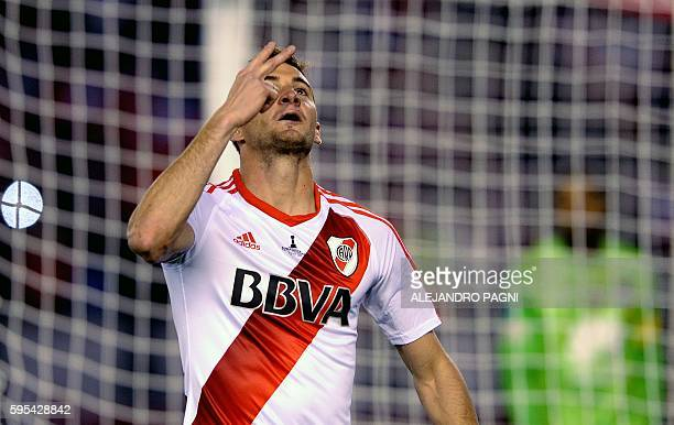 Argentina's River Plate forward Lucas Alario celebrates after scoring the team's second goal against Colombia's Independiente Santa Fe during their...