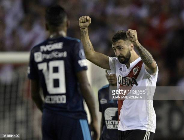Argentina's River Plate forward Lucas Pratto celebrates after scoring a goal against Ecuador's Emelec during the Copa Libertadores 2018 group D...