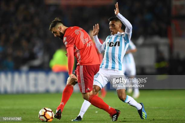 Argentina's River Plate forward Lucas Pratto vies for the ball with Argentina's Racing Club midfielder Federico Zaracho during their Copa...