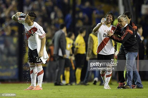 Argentina's River Plate forward Sebastian Driussi and midfielder Leonardo Ponzio react after being pepper sprayed by Boca Junior supporters before...