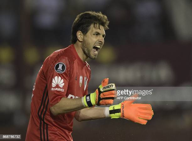 Argentina's River Plate goalkeeper German Lux gestures during the Copa Libertadores 2017 semifinal first leg football match against Argentina's Lanus...