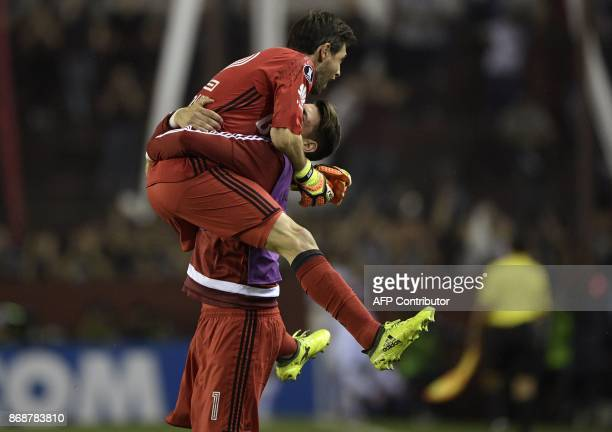 Argentina's River Plate goalkeepers German Lux and Augusto Batalla celebrate after teammate defender Gonzalo Montiel scores the team's second goal...