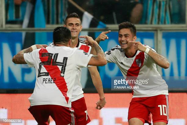 Argentina's River Plate Gonzalo Martinez celebrates with teammates his goal scored against Brazil's Gremio during their 2018 Copa Libertadores...