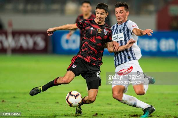 Argentina's River Plate Ignacio Fernandez vies for the ball with Mauricio Affonso from Peru's Alianza Lima during their Libertadores Cup football...