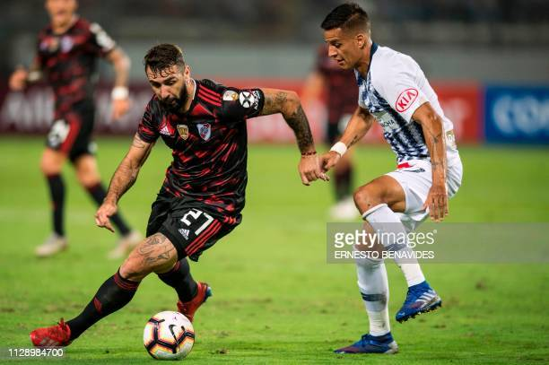 Argentina's River Plate Ignacio Fernandez vies for the ball with Gonzalo Godoy from Peru's Alianza Lima during their Libertadores Cup football match...