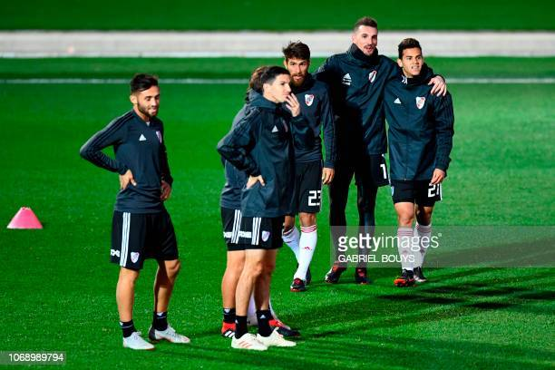 Argentina's River Plate Leonardo Ponzio Argentina's River Plate goalkeeper Franco Armani and Argentina's River Plate Cristian Ferreira attend a...