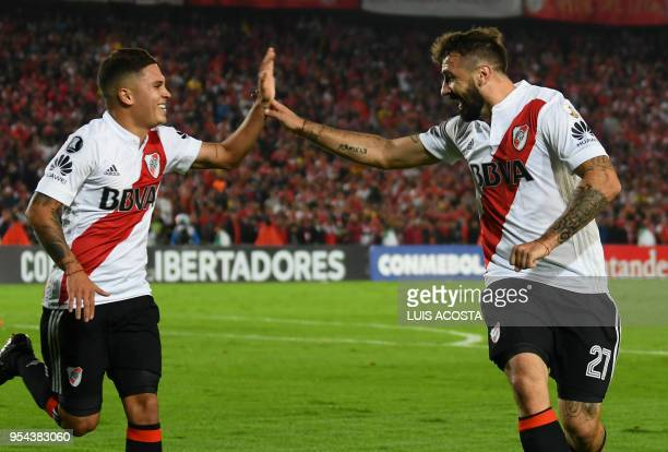 Argentina's River Plate Lucas Pratto and Juan Quintero celebrate after scoring against Colombia's Santa fe during their Libertadores Cup at the El...