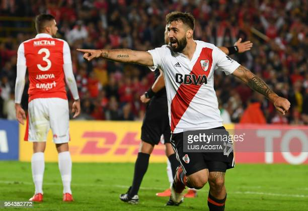 Argentina's River Plate Lucas Pratto celebrates after scoring a goal against Colombia's Santa fe during their Libertadores Cup at the El Campin...