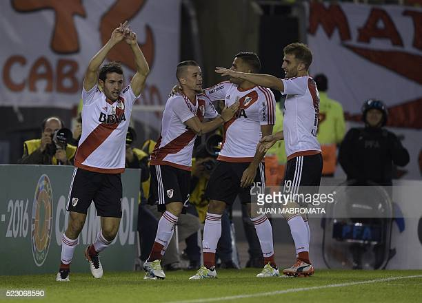 Argentina's River Plate midfielder Camilo Mayada celebrates next to teammates midfielder Andres D'Alessandro defender Gabriel Mercado and forward...
