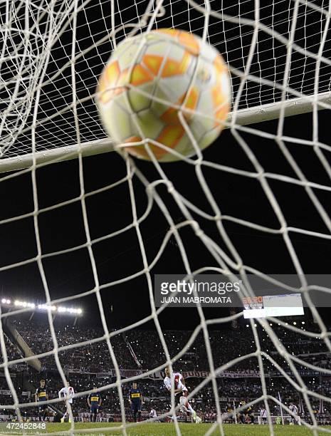 Argentina's River Plate midfielder Carlos Sanchez celebrates after scoring a penalty shot against Argentina's Boca Juniors during the Copa...