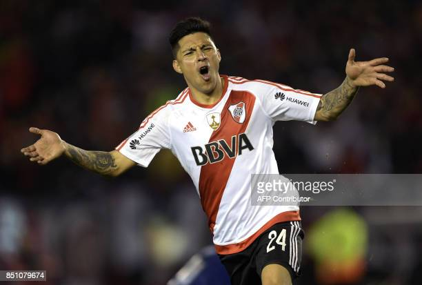 Argentina's River Plate midfielder Enzo Perez celebrates after scoring his second and the team's eighth goal against Bolivia's Wilstermann during the...