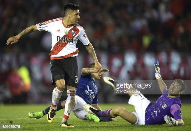 Argentina's River Plate midfielder Enzo Perez reacts next to Bolivia's Wilstermann goalkeeper Raul Olivares after scoring his second and the team's...