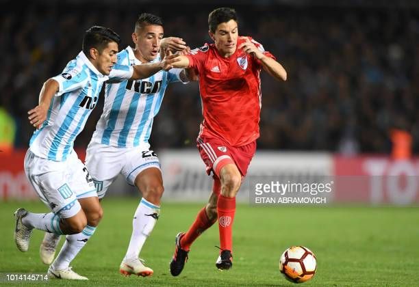 Argentina's River Plate midfielder Ignacio Fernandez vies for the ball with Argentina's Racing Club defender Alexis Soto and forward Ricardo...