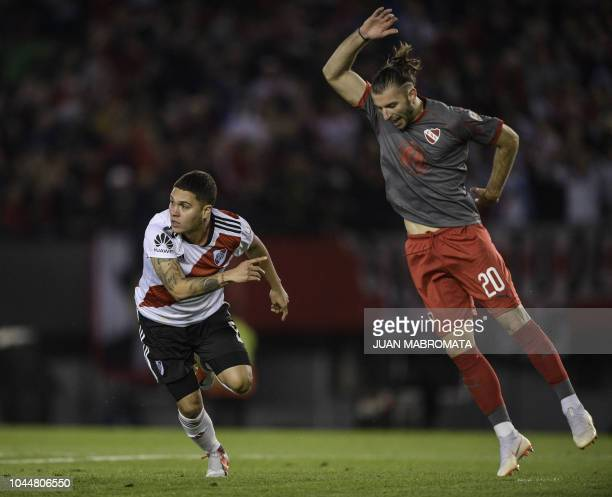 Argentina's River Plate midfielder Juan Quintero celebrates after scoring the team's second goal against Argentina's Independiente during the Copa...