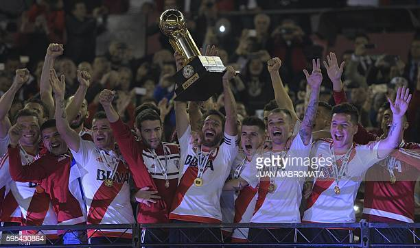 Argentina's River Plate midfielder Leonardo Ponzio raises the trophy of the Recopa Sudamericana 2016 after wining by 21 its final football match...