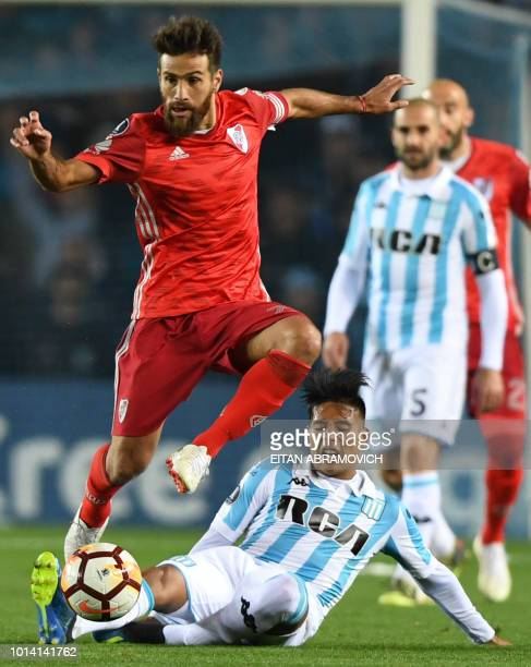 Argentina's River Plate midfielder Leonardo Ponzio vies for the ball with Argentina's Racing Club midfielder Federico Zaracho during their Copa...