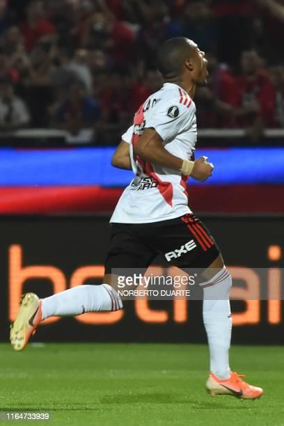Argentina's River Plate Nicolas de la Cruz celebrates after scoring during a Copa Libertadores football match between Paraguay's Cerro Porteno and...