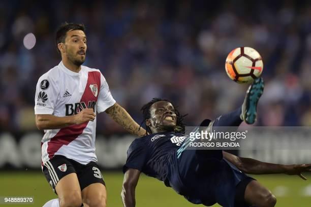 TOPSHOT Argentina's River Plate player Ignacio Scocco vies for the ball with Ecuador's Emelec player Juan Paredes during their Copa Libertadores...