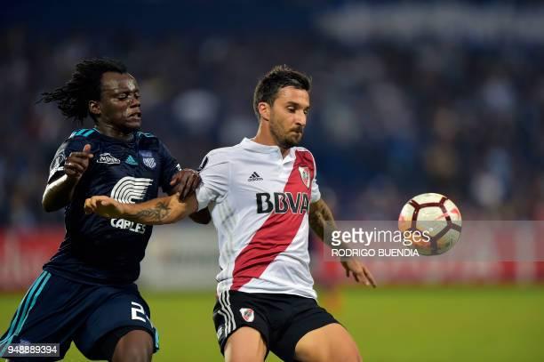 Argentina's River Plate player Ignacio Scocco vies for the ball with Ecuador's Emelec player Juan Paredes during their Copa Libertadores football...