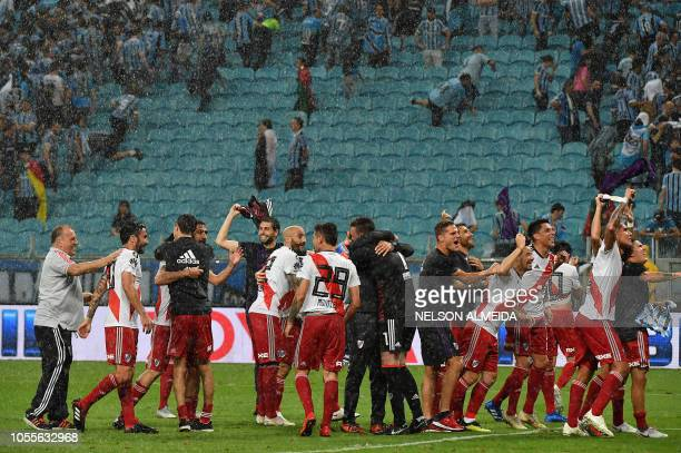 Argentina's River Plate players celebrate after defeating Brazil's Gremio during their 2018 Copa Libertadores football semifinal match held at Gremio...