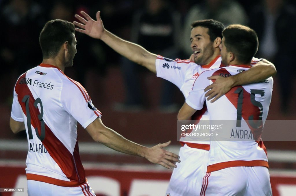 Argentinas River Plate players celebrate after scoring against Peru's Melgar during their Copa Libertadores football match at the UNSA Stadium in the Andean city of Arequipa, on May 18, 2017. /
