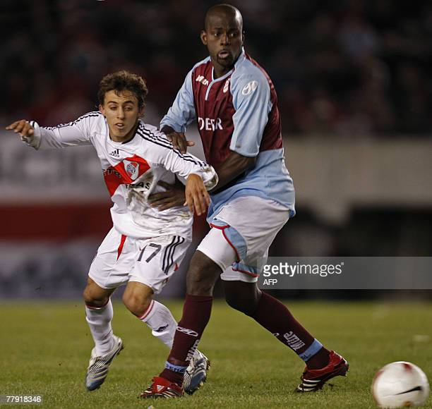 Argentina's River Plate's Diego Buonanotte vies for the ball with Jossimar Mosquera of Arsenal during their Copa Sudamericana semifinals football...