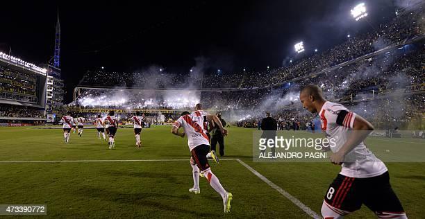 Argentina's River Plates footballers enter the field before their Copa Libertadores 2015 quarterfinals second leg football match against Boca Juniors...