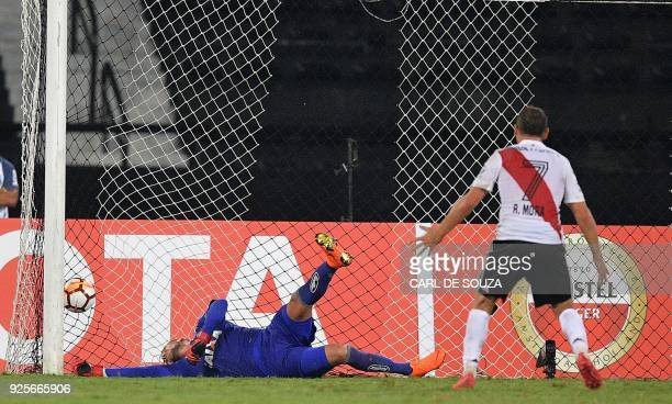 Argentina's River Plate's Rodrigo Mora scores an equaliser past Brazil's Flamengo's goalkeeper Diego Alves during their group stage Libertadores...