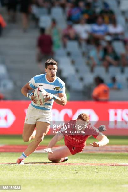 Argentina's Rodrigo Etchart avoids a tackle from Canada Connor Braid during the semifinal Argentina vs Canada during the second day of the World...