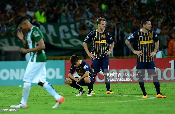 Argentina's Rosario Central players react at the end of their match against Colombia's Atletico Nacional during the Copa Libertadores 2016 football...