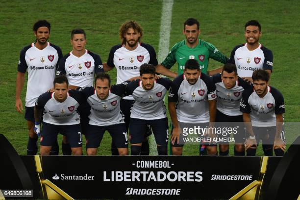 Argentina's San Lorenzo footballers pose for pictures before their Libertadores Cup football match against Brazil's Flamengo at the Maracana stadium...