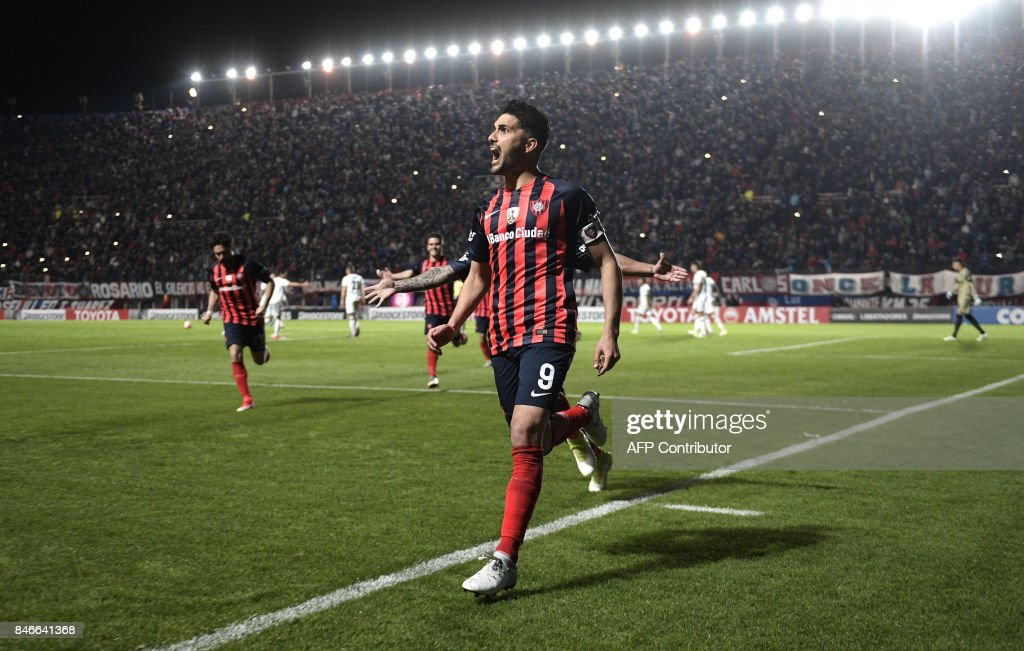 Argentina's San Lorenzo forward Nicolas Blandi celebrates after scoring his second goal against Argentina's Lanus during the Copa Libertadores 2017 quarterfinals first leg football match at Pedro Bidegain stadium in Buenos Aires, Argentina, on September 13, 2017. /