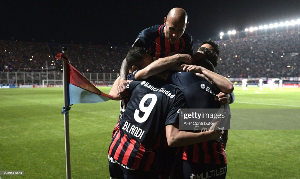 Argentina's San Lorenzo forward Nicolas Blandi (front-L) celebrates with teammates after scoring his second goal against Argentina's Lanus during the Copa Libertadores 2017 quarterfinals first leg football match at Pedro Bidegain stadium in Buenos Aires, Argentina, on September 13, 2017. /