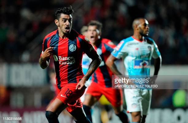 Argentina's San Lorenzo midfielder Roman Martinez celebrates after scoring against Colombia's Junior during a Copa Libertadores Group F football...