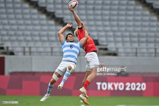 Argentina's Santiago Alvarez and Britain's Ben Harris jump for the ball in the men's bronze medal rugby sevens match between Britain and Argentina...