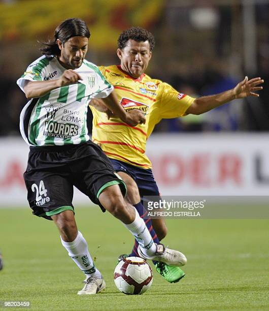 Argentina´s Santiago Ladino from Banfield fights for the ball against Miguel Sabah from Mexico´s Morelia during their Copa Libertadores football...