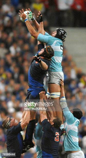 Argentina's scrum-half Agustin Pichot goes up against France's lock Jerome Thion in a line outduring the rugby union World Cup opening match France...
