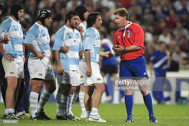 Argentina's scrum-half and captain Agustin Pichot speaks with Australian referee Stuart Dickinson during the rugby union World cup match Argentina...